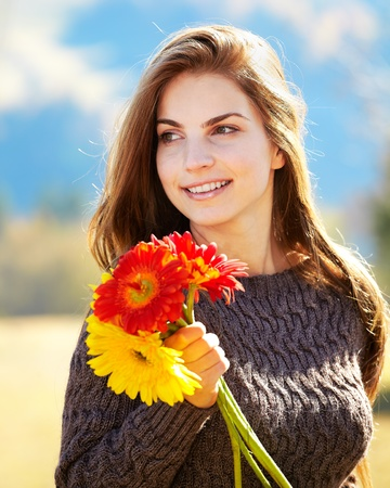 Beautiful brunette with long hair spending a day outdoor in the countryside. Stock Photo - 12549167