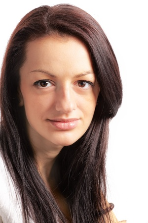 suave: Studio portrait of a beautiful 20 year old brunette against white.