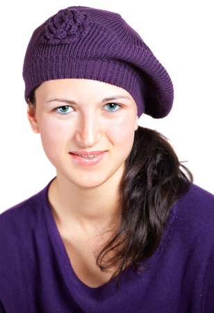 sixteen year old: Portrait of a beautiful teenage girl wearing purple hat and top