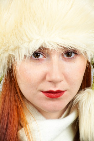 20 year old: Headshot of an elegant 20 year old redhead wearing a furry hat  Stock Photo