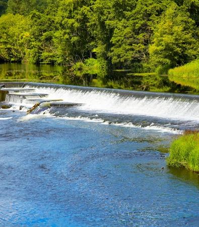 liffey: Artificial waterfall on River Liffey in summer season, Ireland