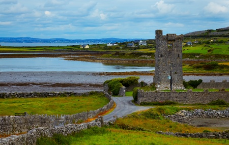 Muckinishnoe Tower House (Pouldoody Castle) during summer season in county Clare, Ireland. photo