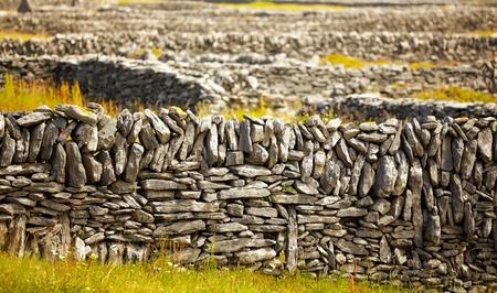 Rows of stone traditional irish fences on Inisheer Island, Ireland.