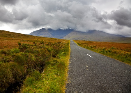 Road in the countryside towards Sheefry hills in summertime, county Mayo, Ireland. photo