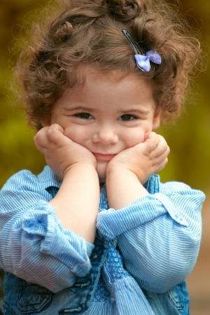 Portrait of happy two year old little girl outdoor. Stock Photo