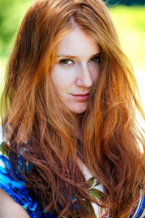 20 year old: Portrait of a beautiful 20 year old redhead woman outdoor. Stock Photo