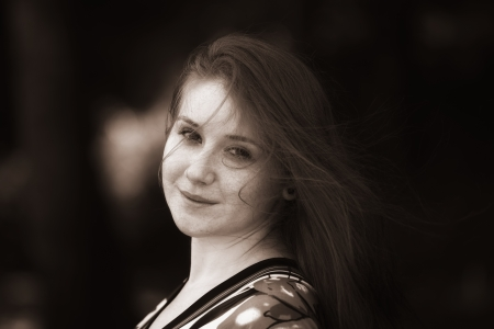 20 year old: Portrait of a beautiful 20 year old redhead woman in sepia.