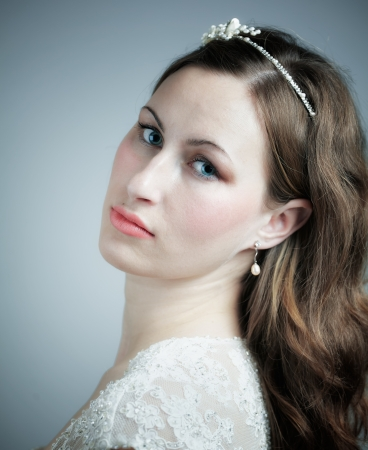 Studio portrait of a beautiful young bride, head shot. photo