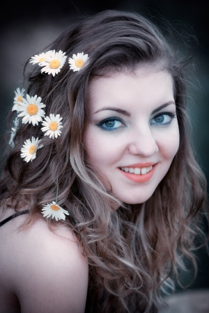 20 year old woman with flowers in her hair portrait. Stock Photo - 17050668