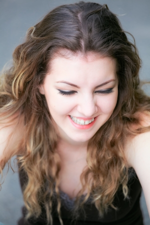 laughing out loud: Portrait of a happy caucasian young woman laughing.