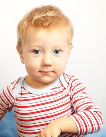 joyfull: Studio portrait of a happy one year old baby boy. Stock Photo
