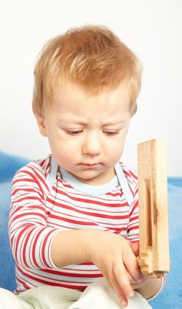 pouty: Studio portrait of a sad one year old baby boy. Stock Photo