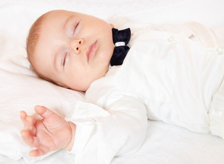 Baby boy dressed for party sleeping peacefully. Stock Photo - 17501234