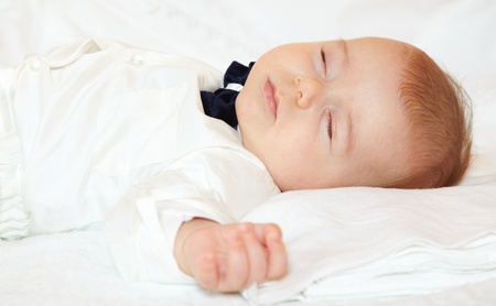 Baby boy dressed for party sleeping peacefully. Stock Photo - 17501236