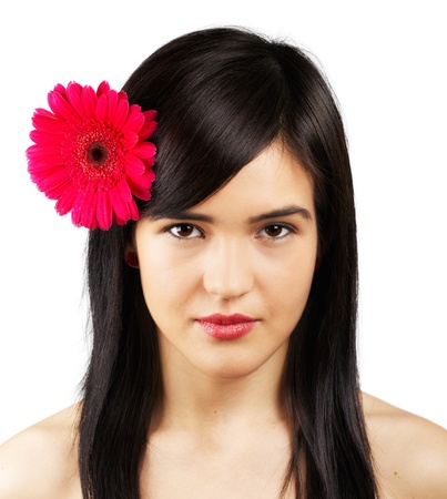 Portrait of a beautiful young woman with a flower in her hair isolated on white. Stock Photo - 17964004