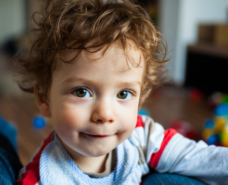 1 year old: Portrait of 1 year old baby boy at home.