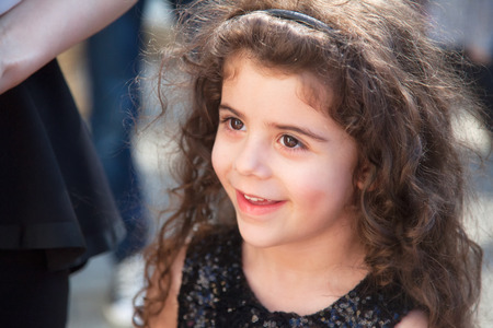 5 year old: Portrait of 5 year old little girl with curly hair outdoor.