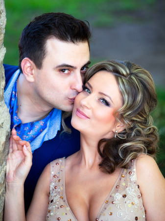 wed: Newly wed couple kissing outdoor on a summer day. Stock Photo