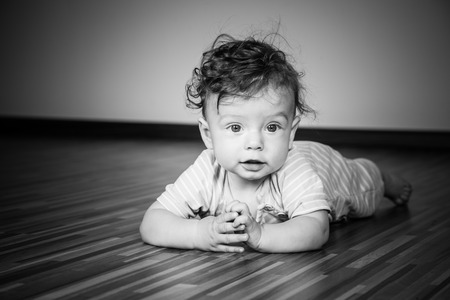7 months: Portrait of a 7 months old baby boy at home.