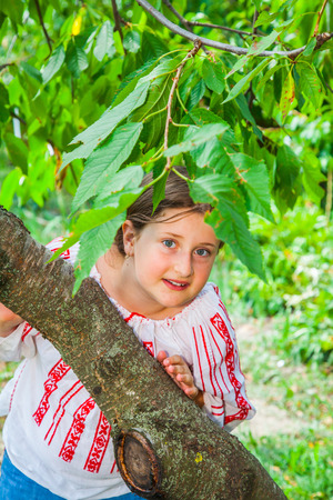10 year old: Portrait of a 10 year old girl wearing a Romanian traditional blouse.