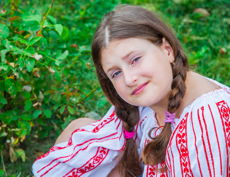 sarcastic: Portrait of a 10 year old girl wearing a Romanian traditional blouse.