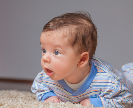 strenghten: Portrait of a 2 months old baby boy at his home.