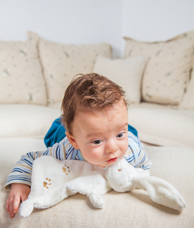 2 months: Cute 2 months old baby boy at home on the sofa. Stock Photo