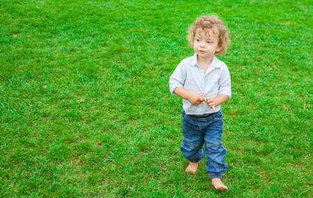 liesure: Portrait of 1 year old baby boy in the park.
