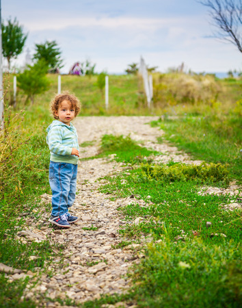 toddler boy: 1 year old baby boy walking through the countryside.