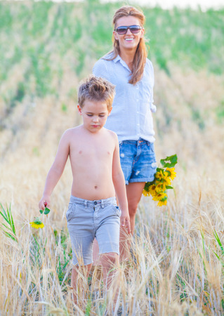 5 year old: Portrait of a 5 year old boy enjoying outdoors with his mother.