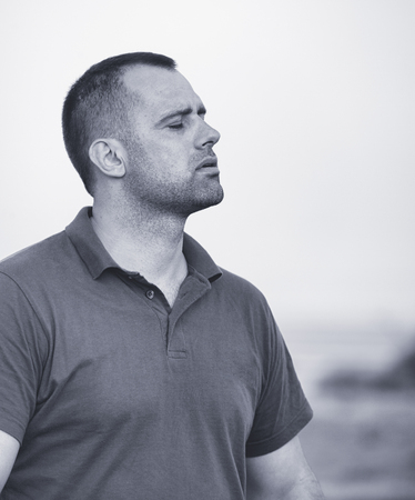 30 year old: Black and white portrait of a man in his 30s outdoor.