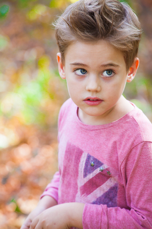 5 year old: 5 year old boy portrait outdoor in autumn.
