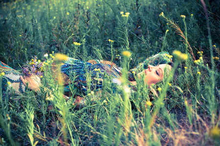 laying down: Pregnant woman laying down relaxing in nature. Stock Photo