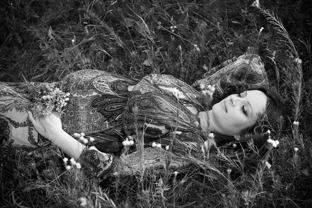 woman laying down: Pregnant woman laying down relaxing in nature. Stock Photo