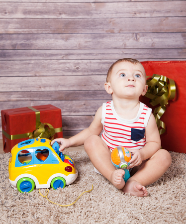 boy 12 year old: Portrait of 1 year old baby boy, with presents, studio shot.