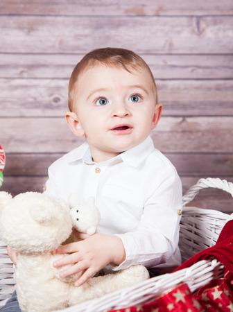 boy 12 year old: Portrait of 1 year old baby boy, Christmas theme, studio shot.