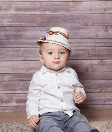 boy 12 year old: Portrait of a 1 year old baby boy wearing a Romanian traditional hat.