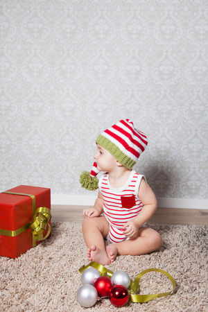boy 12 year old: Portrait of 1 year old baby boy, Christmas theme, studio shot.
