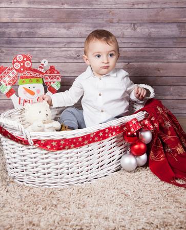 one year: Portrait of 1 year old baby boy, Christmas theme, studio shot.