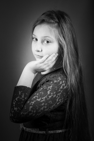 10 year old: Portrait of a 10 year old girl, studio shot. Stock Photo