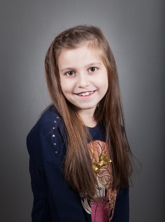 8 year old: Portrait of a 8 year old girl, nicely dressed, studio shot. Stock Photo