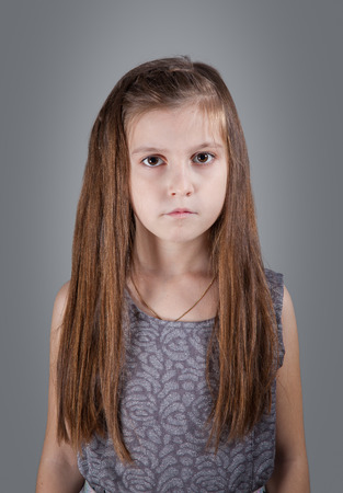8 year old girl: Portrait of a 8 year old girl, nicely dressed, studio shot. Stock Photo