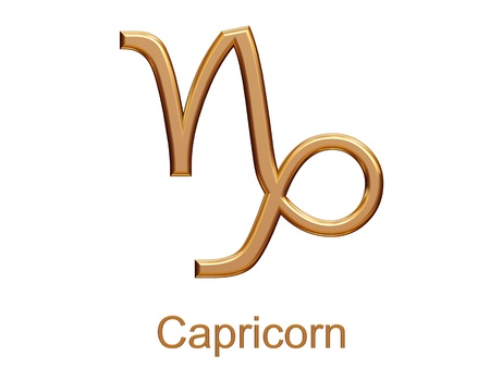 capricorn - golden astrological zodiac symbol isolated on white photo