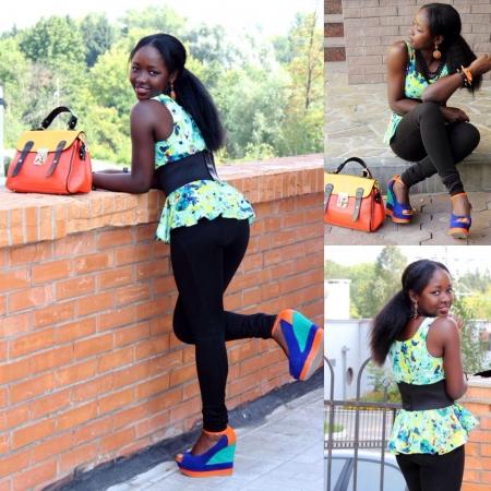 pants: A black girl on a peplum top n a skinny pants
