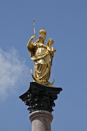 female likeness: Germany, Munich, Marienplatz, Virgin Mary atop the Mariensäule Editorial