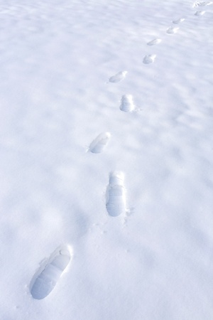 Foot steps on white snow