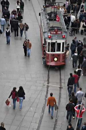 Istanbul, Turkey - October 18, 2008: Tram and walking people, Istiklal street, Beyoglu, Beyoglu one of the most famous street of Istanbul.