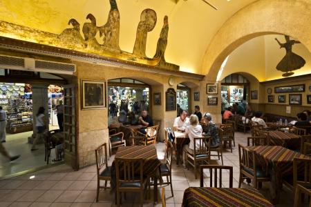 sark: Istanbul, Turkey - June, 8th 2012  People resting and having Turkish coffee in historical Sark Kahvehanesi  Cafe