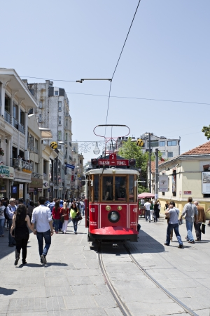 Istanbul, Turkey - October 18, 2008  Tram and walking people, Istiklal street, Beyoglu, Beyoglu one of the most famous street of Istanbul for tourists for tourits