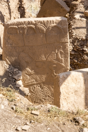 Gobekli Tepe Potbelly Hill is an archaeological site  in the Southeastern Anatolia Region of Sanliurfa, Turkey. Gobekli Tepe has been dated to about the close of the 10th millennium BCE. Stock Photo